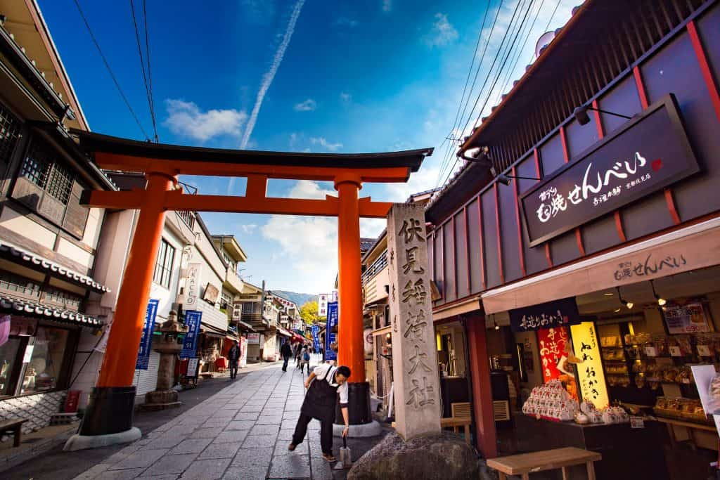 A Japanese torii shrine gate and shop. Want to visit Japan? You need to learn Japanese with our tips for beginners at Team Japanese!