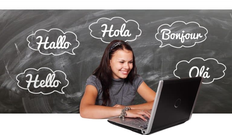 girl learning another language with computer and blackboard - so many benefits!