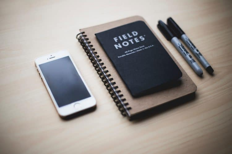 notebooks, phone and pens - ready to learn japanese grammar